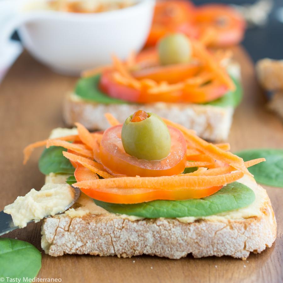 Tasty-mediterraneo-hummus-raw-veggies-olives-toast