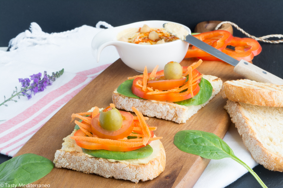 Tasty-mediterraneo-hummus-veggies-olives-on-toast