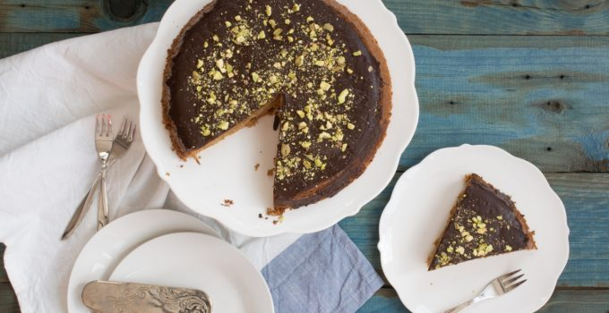 Spelt cake with chocolate & pistachio topping