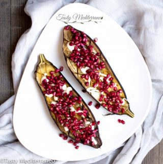 Roasted aubergine with tarator sauce & pomegranate seeds